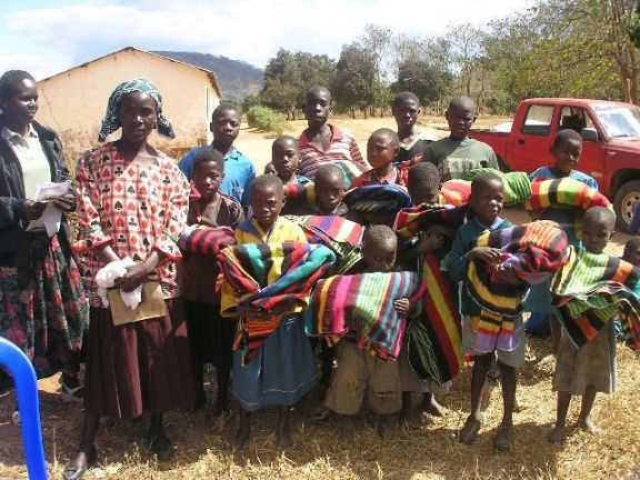 Hand out blankets for the orphans